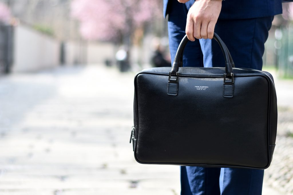 ESAT survey - career image - Man in blue suit holding black leather laptop bag