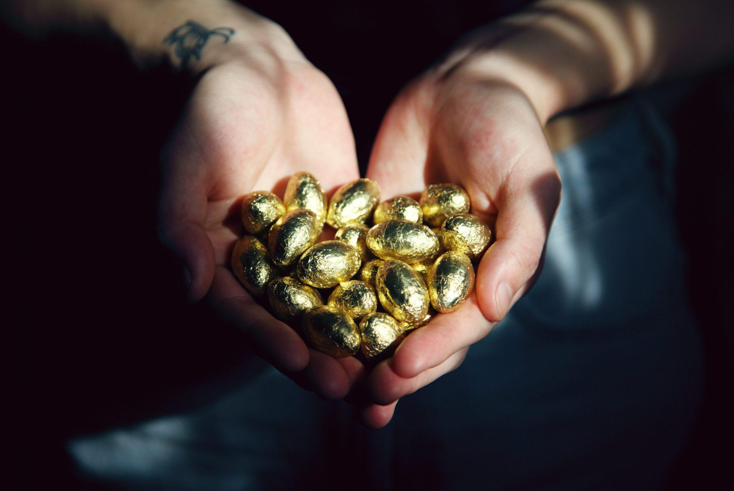 ESAT survey - value image - hands holding golden foil-wrapped eggs